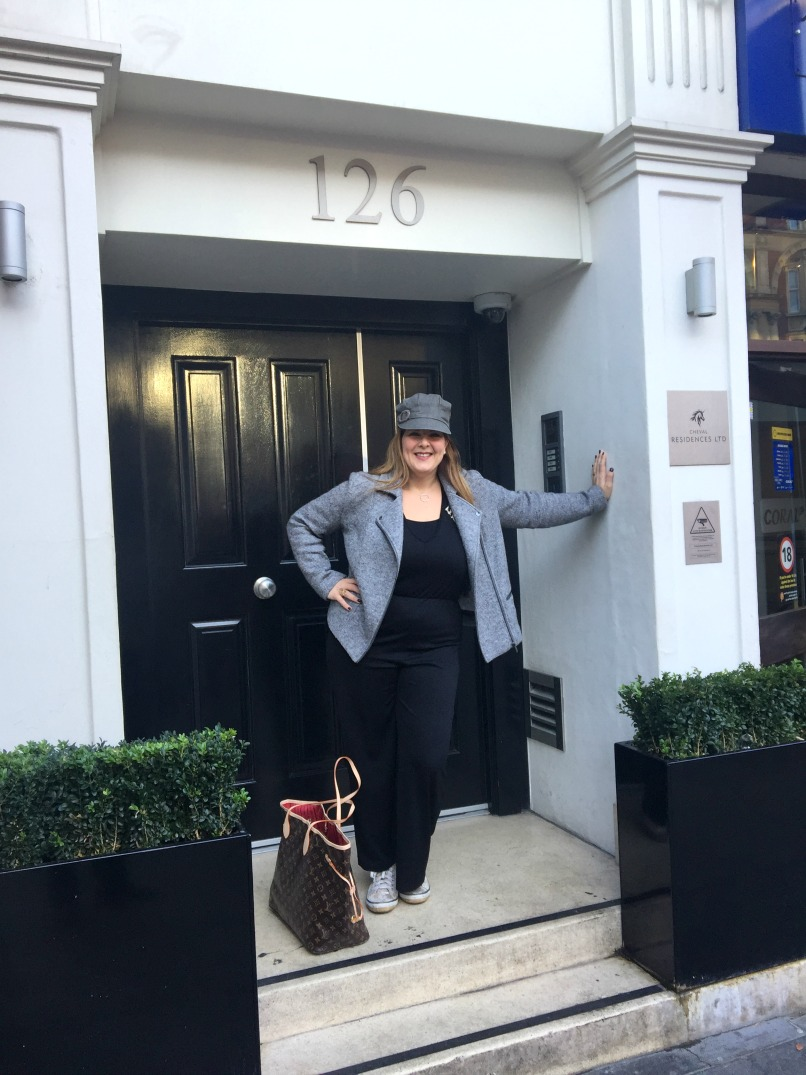 I'm in the doorway of my apartment block, Brompton Road, Knightsbridge