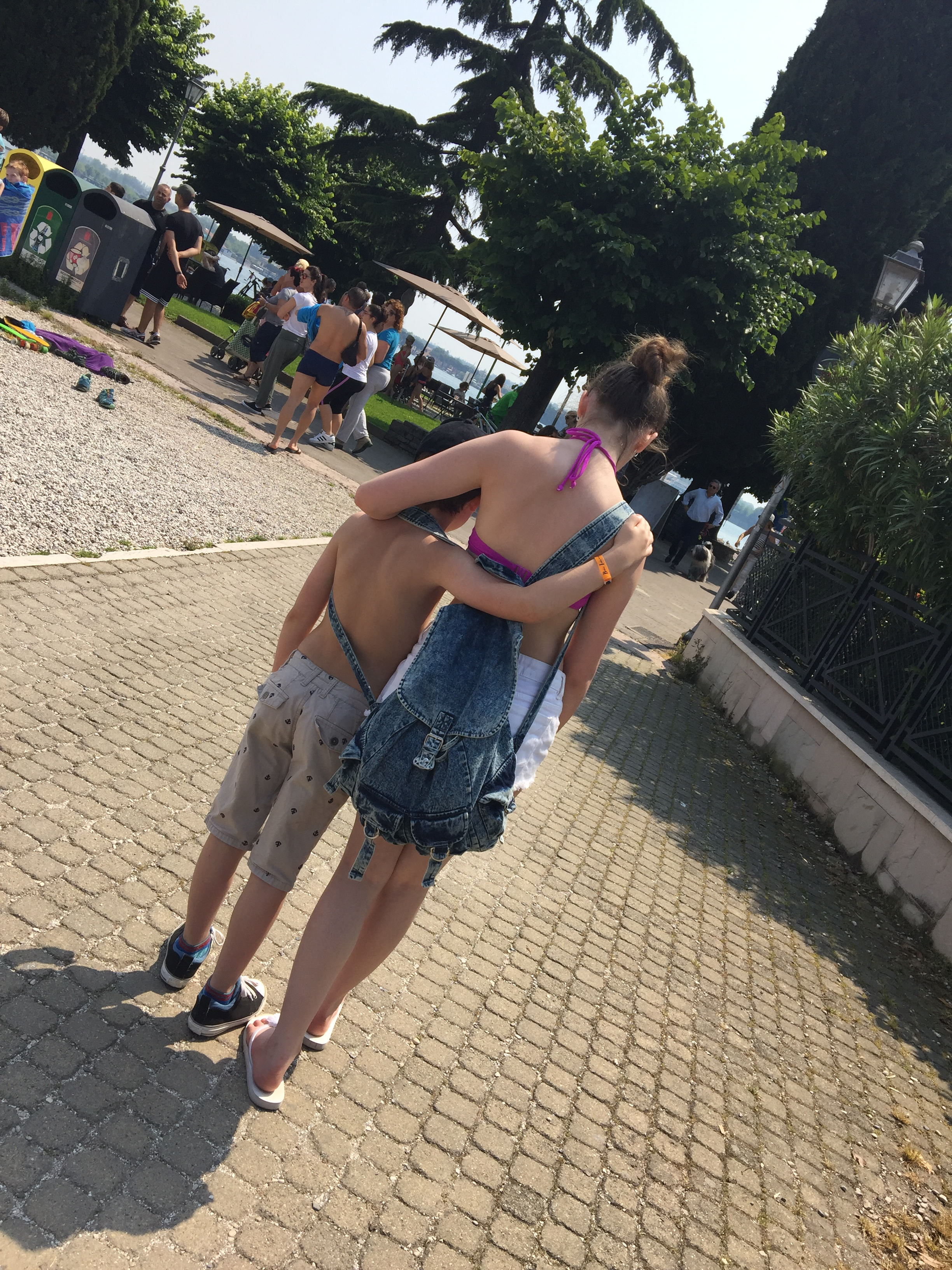 siblings arm in arm