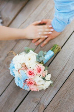 couple married wedding together bouquet