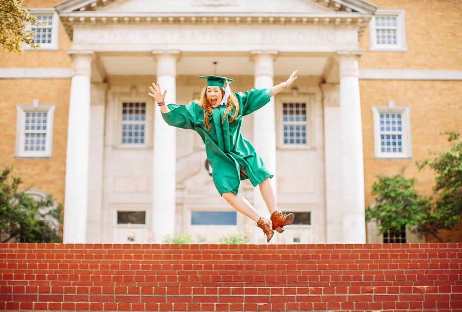 graduate adult jumping for joy